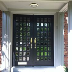 Double front doors with small beveled glass panes in Short Hills, NJ