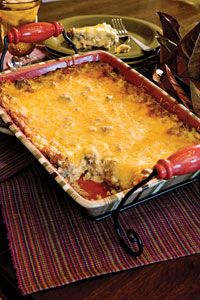Easy Mexican Casserole. 2#'s ground chuck, 1 med diced onion, 1 can cream chicken soup, 1 can cream mushroom soup, 12 oz can evaporated milk, 4 oz can chopped green chillies, 12 corn tortillas & 1 C cheddar cheese.