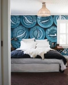 """Jess says the master bedroom's Caviar wallpaper from Go Home was """"really expensive but I had to have it"""" – she bought it ..."""