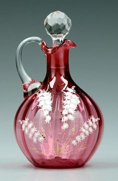 Decorated cranberry cruet, clear glass handle and stopper, enamel and gilt lily-of-the-valley