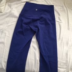 Blue lulu lemon full length leggings size 4 I bought these from another posher but they are too tight on me  I love them but I can't fit in them they are suffocating my ass and legs. Someone take them off my hands ! lululemon athletica Pants Leggings