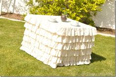 Ruffled Tablecloth-  Would be great for a bedside table to cover a cheap table and create great storage space.