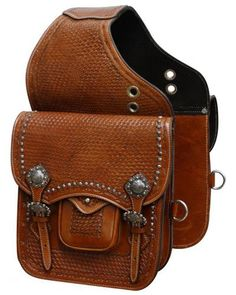 Showman Tooled leather saddle bag with engraved brushed nickel hardware. This saddle bag features basket weave tooling accented with engraved nickel conchos and hardware and comes equipped with front