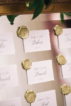 gold wax seals and white escort cards