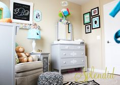 I like the layout of this room. And I need to get a comfy nursing chair like this with a little side table