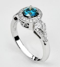 Blue Center Diamond Engagement Ring with a Halo of White Diamonds.
