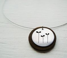 Sprouting seeds, a happy sign of spring. A modern necklace for everyday. Original design hand drawn and sawn on thick aluminum sheet, mounted to a
