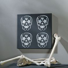 Create an easy stenciled skull canvas to give your walls a frightening look for the Halloween season.