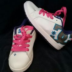 DC Skateboard Shoes 7Y Awesome DC Skateboard shoe size 7Y. White shoes with pink laces.  There is a small scuff mark on the inside of the right shoe, see picture a a few signs of wear. DC Shoes Sneakers