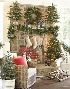Rustic Christmas Mantel...with trees wrapped in burlap and stockings hanging from the mantel.