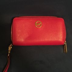 Authentic Michael Kors MK wallet. Gorgeous Authentic MK Michael Kors fushia wallet. Matching purse is also listed. Michael Kors Bags Wallets