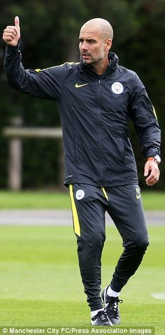 Guardiola gives a thumbs up...