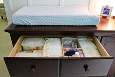 Changing area organisation - use the dresser top drawer as the diaper station and used drawer organisers to keep everything neat & tidy