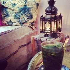 Moroccan elements; Moroccan mint tea, a beautiful wedding blanket and a glass lantern.  #Moroccan #Decor #Elements.