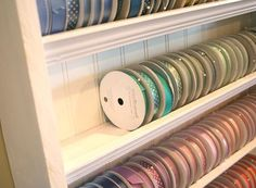with crown molding and beadboard http://nicholeheady.typepad.com/capture_the_moment/studio-ribbon-storage.html