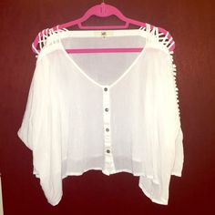 Ladder sleeve top Great loose top with some flare to it! Sleeves are quarter length and the too fits as more of a crop top, though looks great with a longer shirt under it. Some wear but still a great closet piece for a night out or to spice up your jeans and boots! YA Los Angeles  Tops