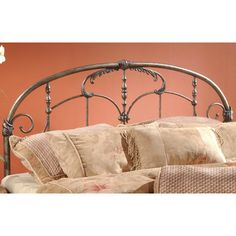 Features:  -Foundry-poured aluminum castings.  -Features 2 holes to screw it into a standard headboard frame.  -Heavy gauge tubing.  Finish: -Old brushed pewter.  Frame Material: -Metal.  Hardware Fin