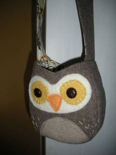 This is a post where a lady shows how she made this cute owl purse out of an old tweed jacket. Awesome!