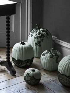Part cobweb, part creeping vine, the effect of black lace on painted pumpkins is thoroughly macabre.