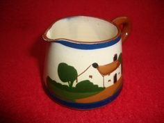 """Torquay Motto Cottage Ware Watcombe Pottery Cream Jug:  Produced by the Watcombe Pottery in the early part of the 20th century , the jug is of tapering form with a cottage decoration to the body and the words """"Fresh from the dairy"""". The piece is fully marked to the base.  Dimensions: 5 cm high - Condition: Excellent - Stock Number: B025 - Price: £12.00"""