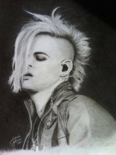 I asked Tommy Joe Ratliff (Adam Lambert's bass player) to stick out his tongue. He's actually pretty shy. Taken in Seattle in 2010 during the Glam Nation Tour.