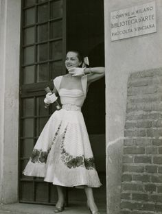 A mannequin poses, at the entrance of Milan Art Library, wearing an outfit of Jole Veneziani.