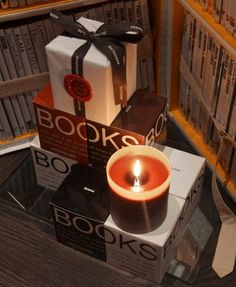 """Assouline Books Candles - these light perfumed candles evoke the atmosphere of your fantasy library, and the pleasure of reading, """"through the enigmatic scent of paper."""""""