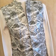 Breathtaking faux snake skin best Wow!!! Look at this vestso chic and sassy!!! This is a Chicos size 2 which means a 12Remember to make this a Poshbox and saveJust see the examples of how your box will arrive based on what other Poshers already purchased Chico's Jackets & Coats Vests