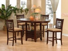 4560 contemporary oval gathering table in solid wood features an 18 inch leaf and has a practical tavern base with storage box and mission styled upholstered chairs.