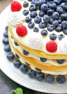 Blueberries and Bavarian Cream Cake Recipe - moist yellow cake, filled with homemade Bavarian cream filling, fresh blueberries and topped with whipped cream.
