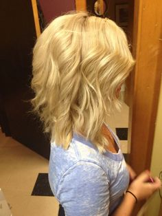 Baby blonde highlight and long angled bob by Lisa at Avantgarde Salon & Spa in Grand Rapids, MI #grandrapids