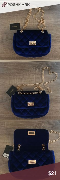 Royal Blue Quilted Velvet Purse Royal Blue Quilted Velvet Purse with gold chain and front snap closure. Chain is convertible, wear with 1 or 2 straps to transform a cross body purse in a shoulder bag and vice versa! Adds style and sophistication to any outfit!  Never worn, new with tags. Forever 21 Bags Crossbody Bags