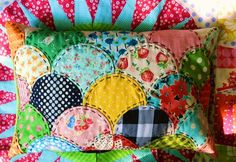 Clam shell quilted pillow sham.