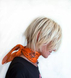 Creepy Spiders hand painted silk scarf. Halloween decorated scarf with black spiders and cobwebs in tangerine orange. Small square scarf