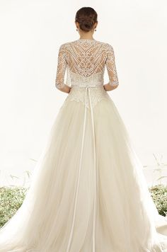 Such a romantic tulle wedding dress with a beautiful jacket over it. Veluz Reyes, 2015