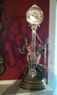 August moreau swinging arm torch star clock