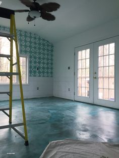 DIY stained concrete is an easy affordable solution for your ugly floors! Come check out how I made mermaid floors in my sunroom!