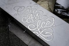 Creating calligraphic art on snow-covered cars