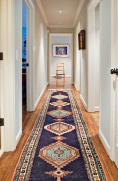 colorful rug makes a long hallway far more interesting