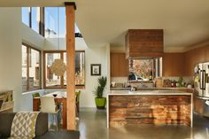 """Cadeddu was particularly drawn to the light and loftiness of the home's main floor. """"I love the open kitchen,"""" she says. (Benjamin Benschneider/The Seattle Times) Seattle Homes, Open Kitchen, Property Management, Apartment Living, My Dream Home, Real Estate, House Design, Flooring, Times"""