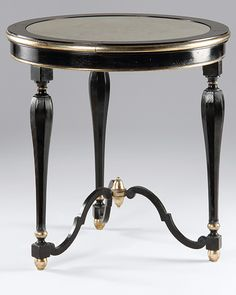 Round table with antiqued black finish, antique silverleaf trim and antiqued mirror top