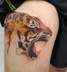 Tiger thigh tattoo by Octaviano.  http://tattooideas247.com/tiger-thigh/