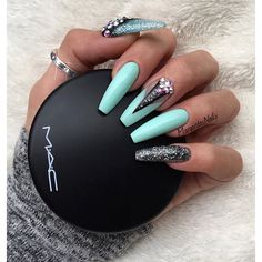 Mint green coffin nails waaay too gahdamn long but the design is cute