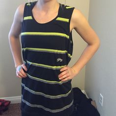 Black and green Billabong loose tank Billabong guys tank but I love to wear it baggy fit. Black with green and gray stripe. It's a large. Billabong Tops Muscle Tees
