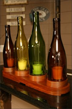 Wooden Stand 4 Wine Bottle Candleholder - This beautiful decorative handcrafted wooden stand wine bottle candleholder is made with four repurposed 750 ml wine bottles and a dark wood for the base. Great for home decor or wine bar decor.