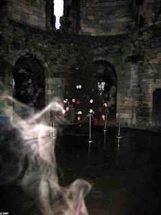 A mysterious ghostly shape has been caught on camera at one of Britain's oldest castles. The bizarre apparition, which cynics believe is a plume of cigarette smoke, appeared in a photo of the chapel in Clifford's Tower in the remains of York Castle Real Ghost Pictures, Creepy Pictures, Ghost Photos, Spooky Places, Haunted Places, Creepy Ghost, Scary, Paranormal Photos, Ghost Paranormal