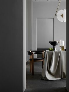 Interior by Apparatus Studio, New York: Synapse-pendant light and Neo-vessel, both by Apparatus Studio. / Apparatus Studio