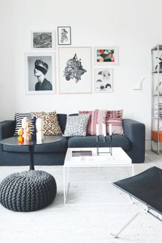 Love this space. Great use of artwork as influence for the colour pallete. Strong blue/grey tones warmed with pops of orange, yellow & pink all set against our friend white. What a cool, relaxed vibe!