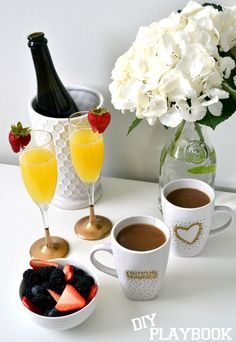 A gold and glamorous brunch. Gold dipped champagne glasses and gold coffee mugs