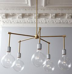 DIY Modern brass chandelier made with scrapped brass pipe